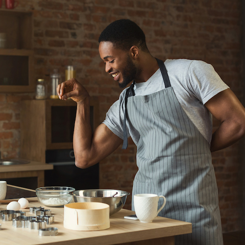 Man baking in kitchen